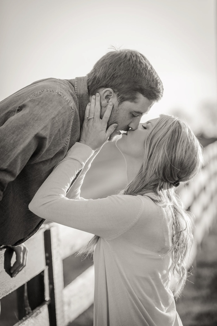 Couple kissing at fence