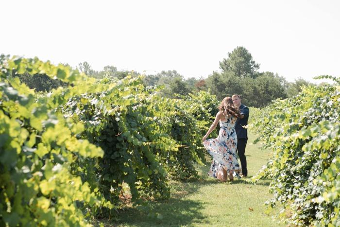 Engaged couple dancing at Morgan Creek Winery vineyards