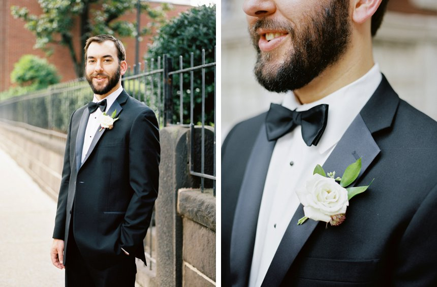 groom in black tux