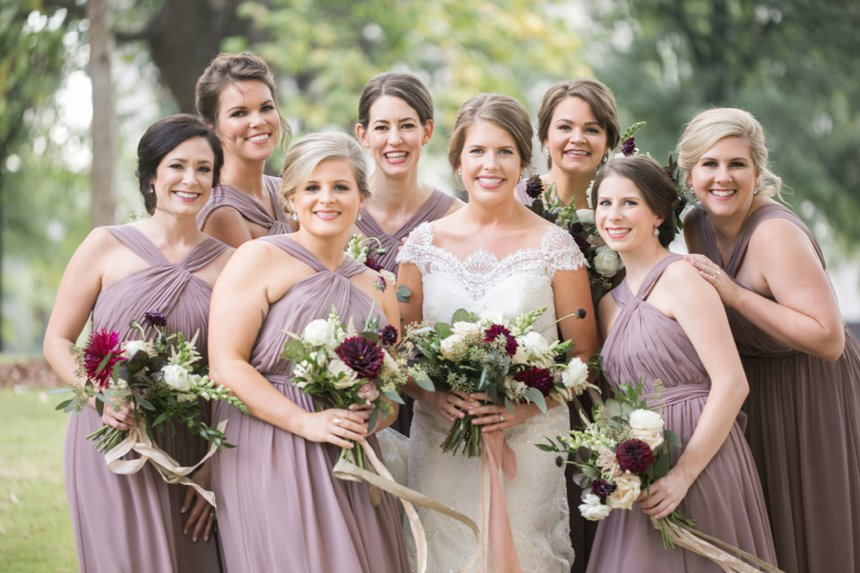 Edna K Flowers and purple bridesmaids dresses