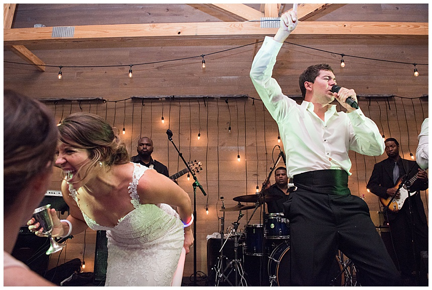 bride and groom sing at reception