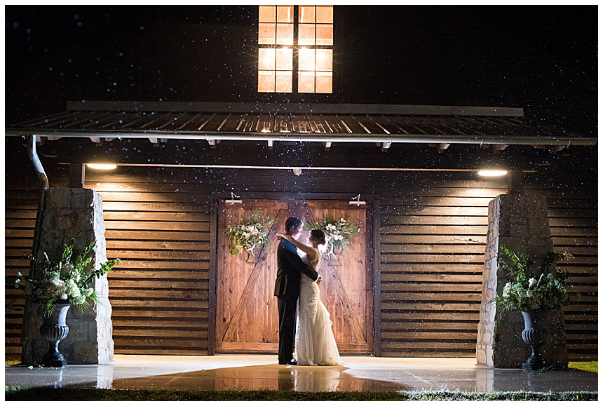 Dramatic Barn at Shady Lane by night  with bride and groom