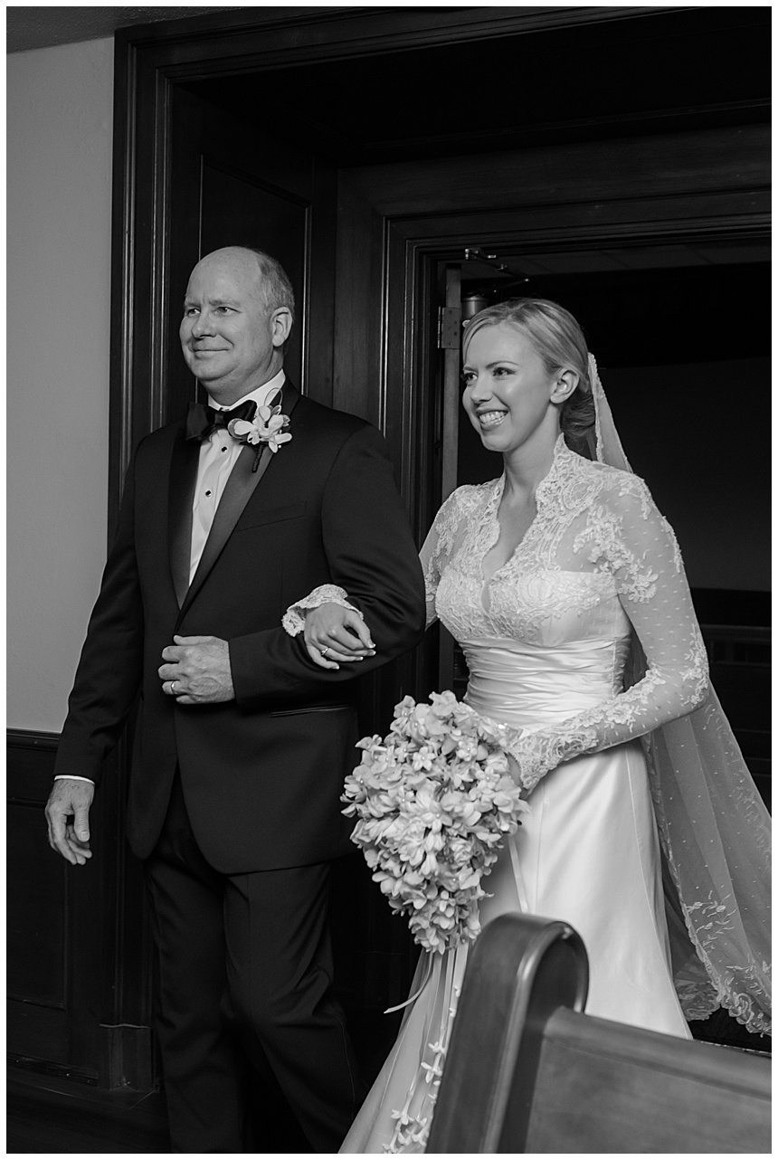 bride and father walking down the wedding aisle