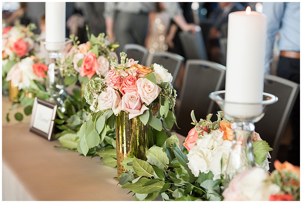 reception table florals at regions field