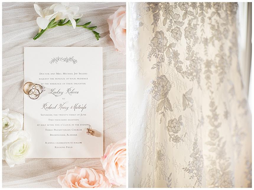 wedding invitation and close up of wedding dress lace