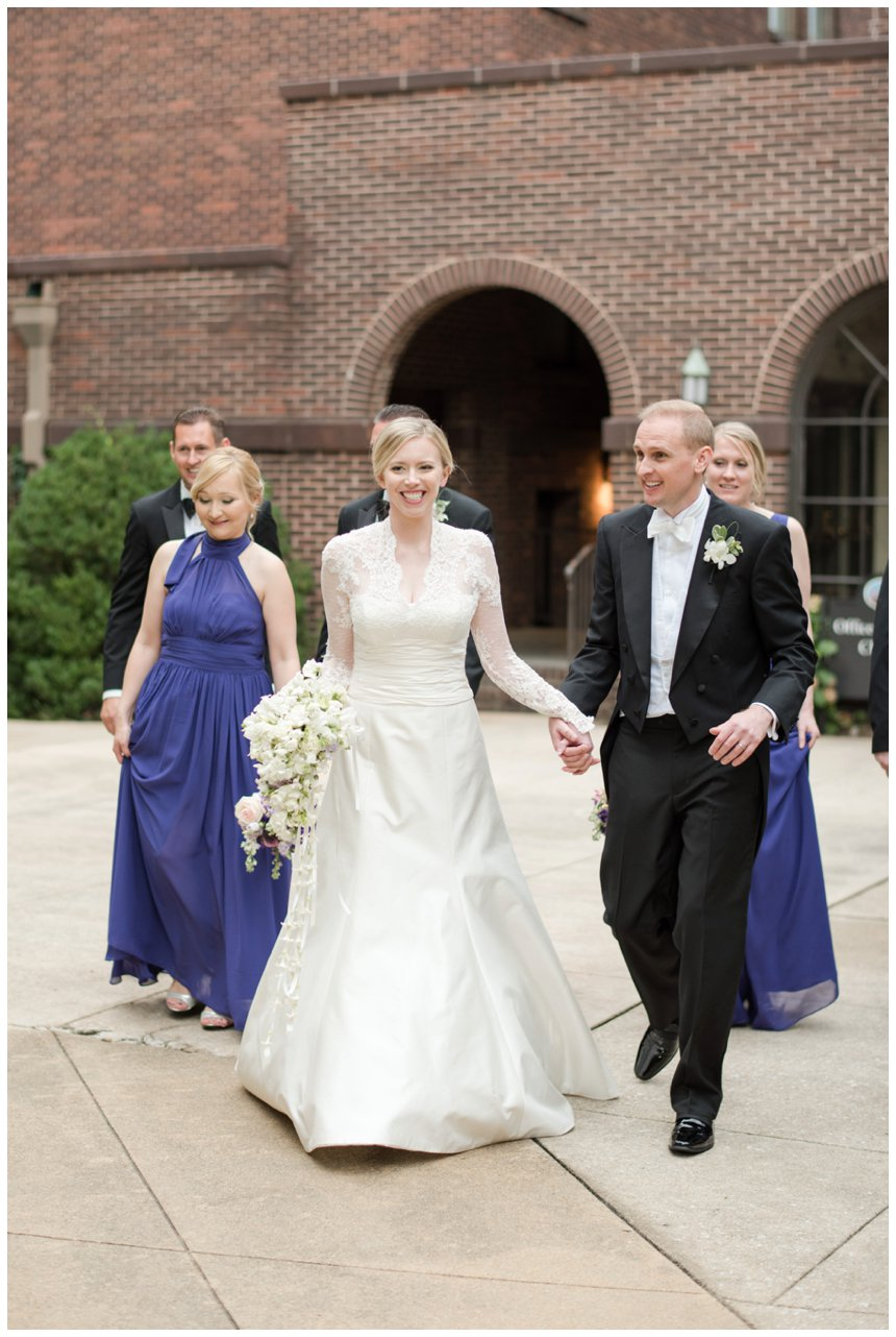 bride groom and purple bridesmaids dresses