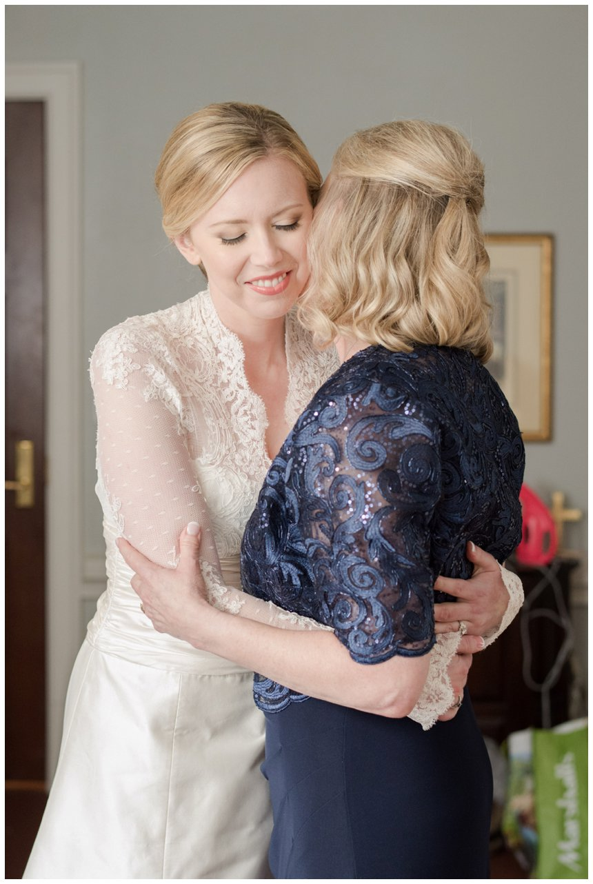Bride and mother of bride hugging